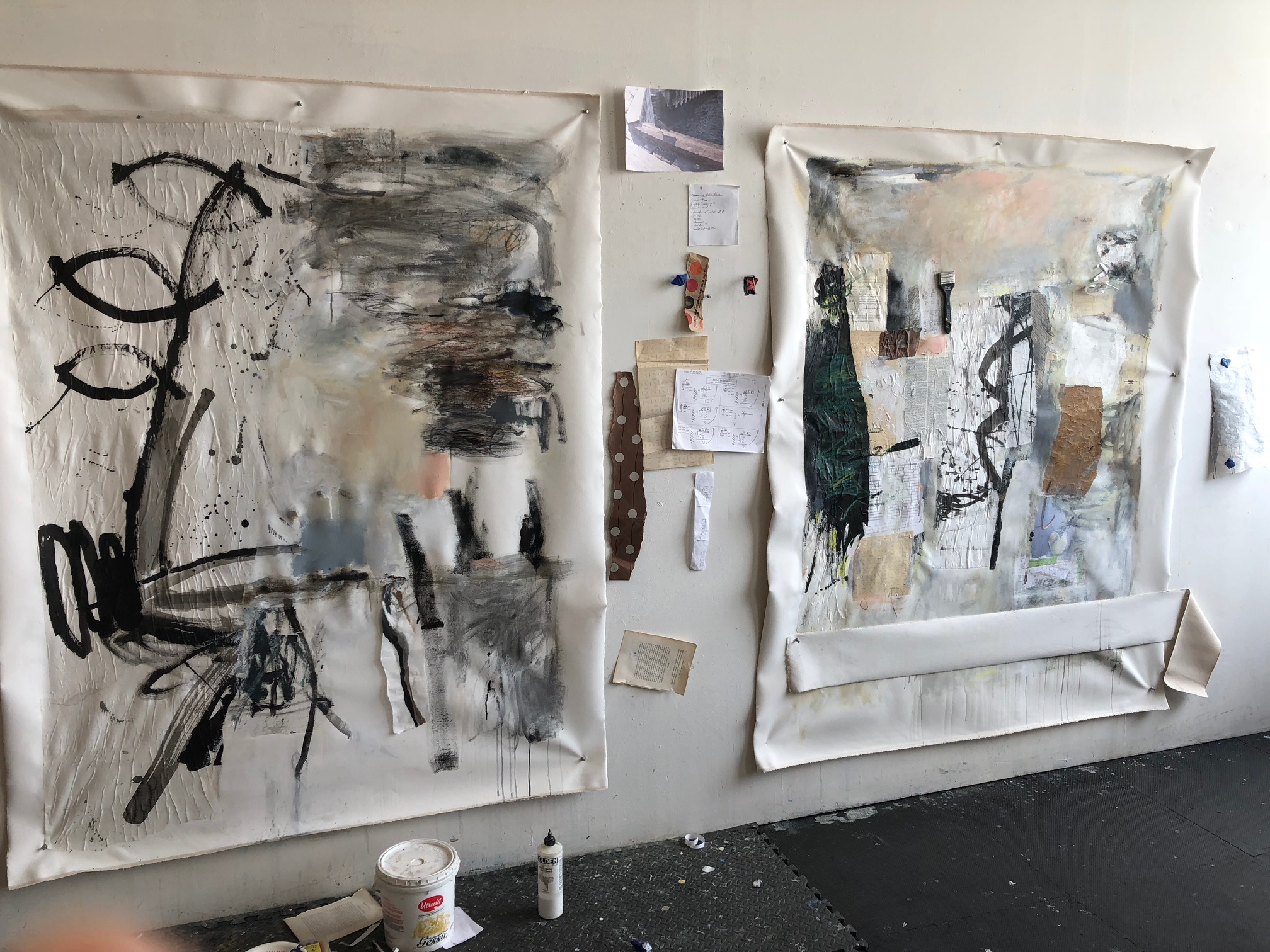 Two paintings with lots of collage and mixed media in progress